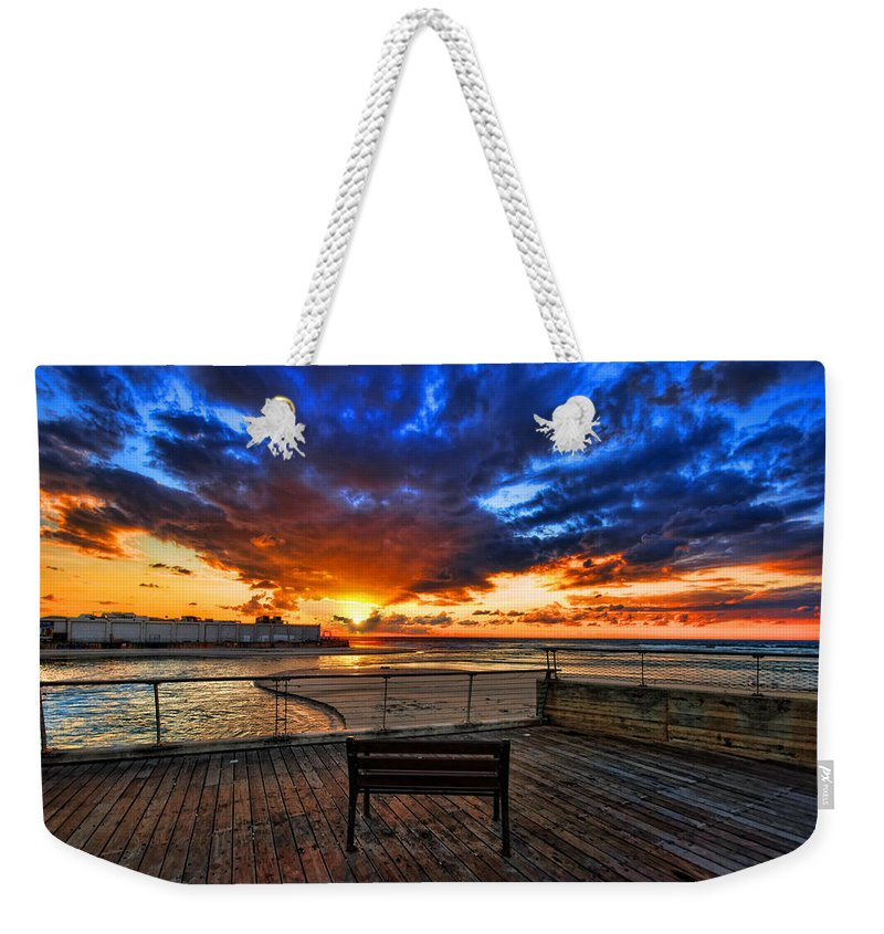 Israel Weekender Tote Bag featuring the photograph sunset at the port of Tel Aviv by Ron Shoshani