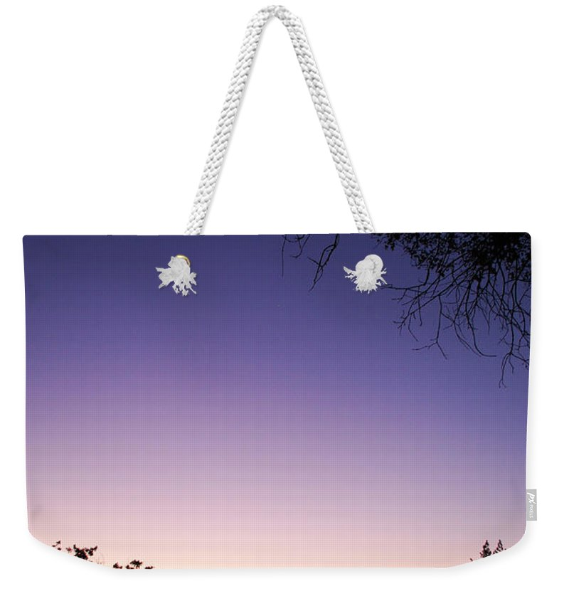 Becky Furgason Weekender Tote Bag featuring the photograph #caughtaridewiththemoon by Becky Furgason