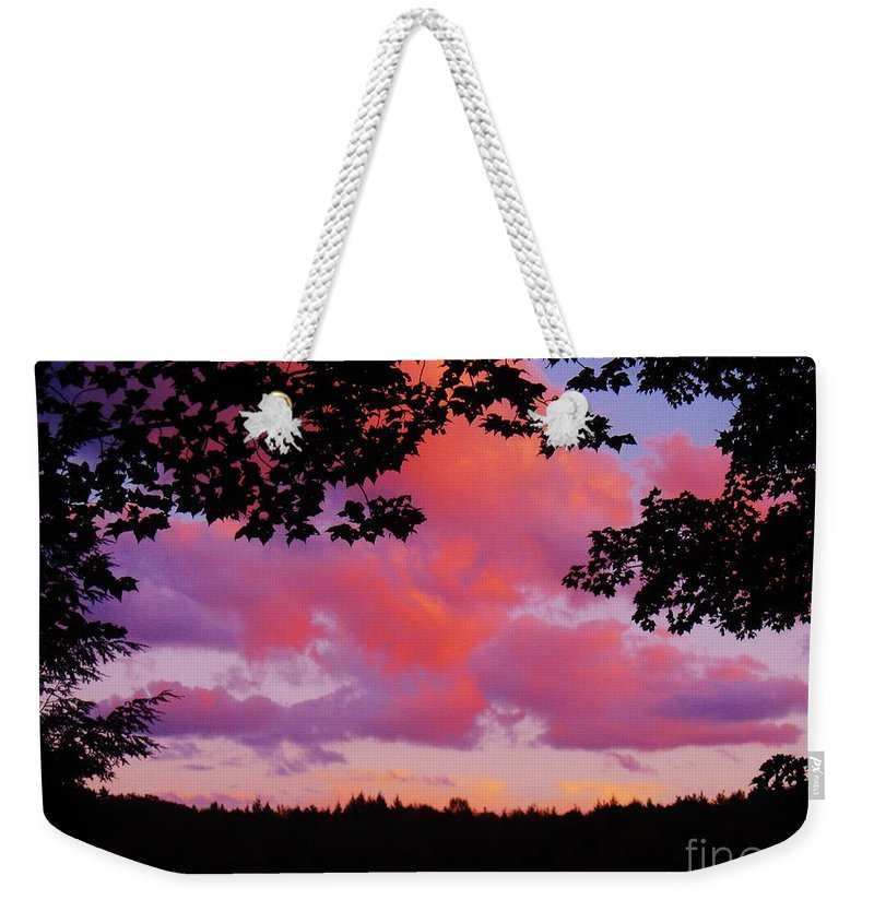 Sunset Clouds Weekender Tote Bag featuring the photograph Sunset Clouds by Janell R Colburn