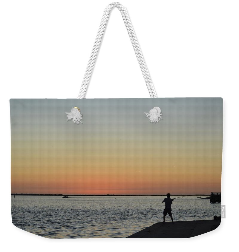 Fishing Weekender Tote Bag featuring the photograph Sunset Fishing by Linda Kerkau
