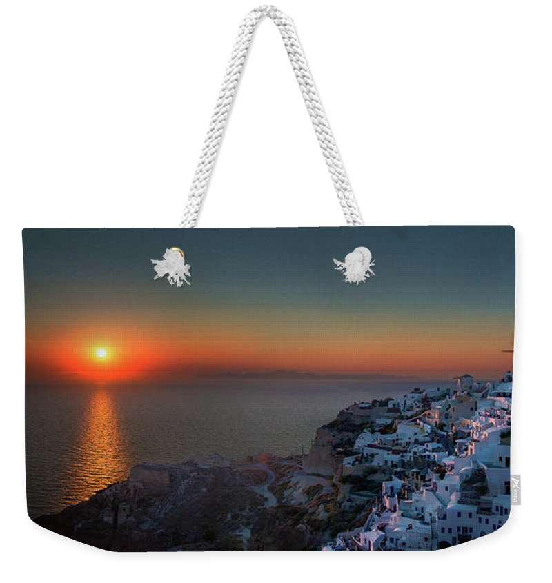 Tranquility Weekender Tote Bag featuring the photograph Sunset In Santorini, Greece by Ed Freeman