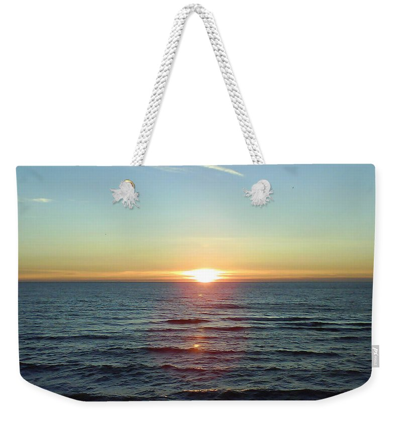 Sunset Over Sea Weekender Tote Bag featuring the photograph Sunset Over Sea by Gordon Auld