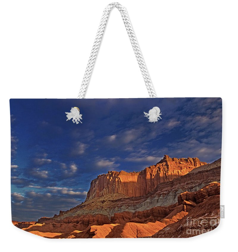 North America Weekender Tote Bag featuring the photograph Sunset Over The Waterpocket Fold Capitol Reef National Park by Dave Welling