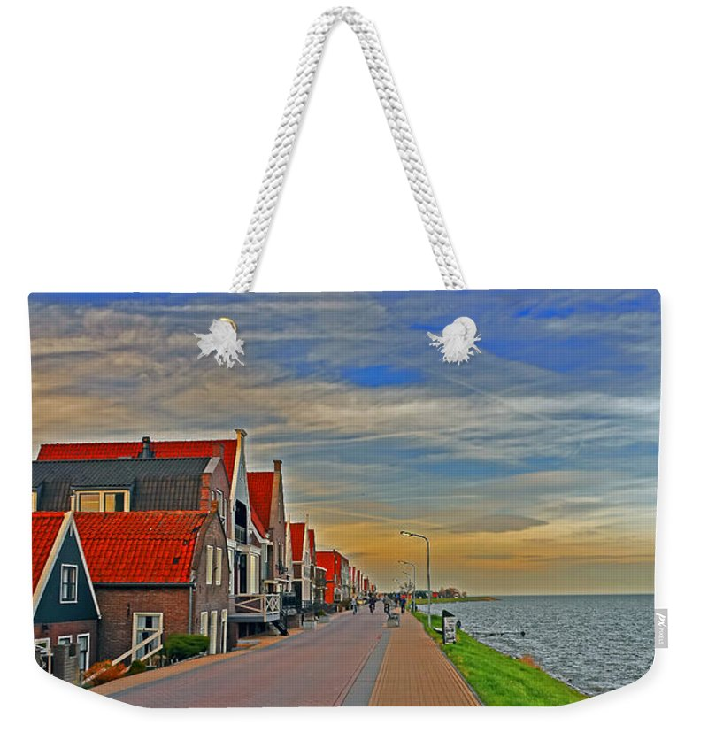 Travel Weekender Tote Bag featuring the photograph Sunset Over Volendam by Elvis Vaughn