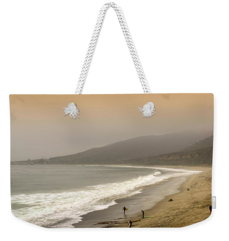 Nicholas Weekender Tote Bag featuring the photograph Sunset Surf by Ricky Barnard
