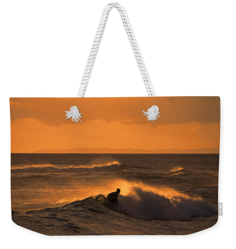 Sunset Weekender Tote Bag featuring the photograph Sunset Surfer by Douglas Barnard