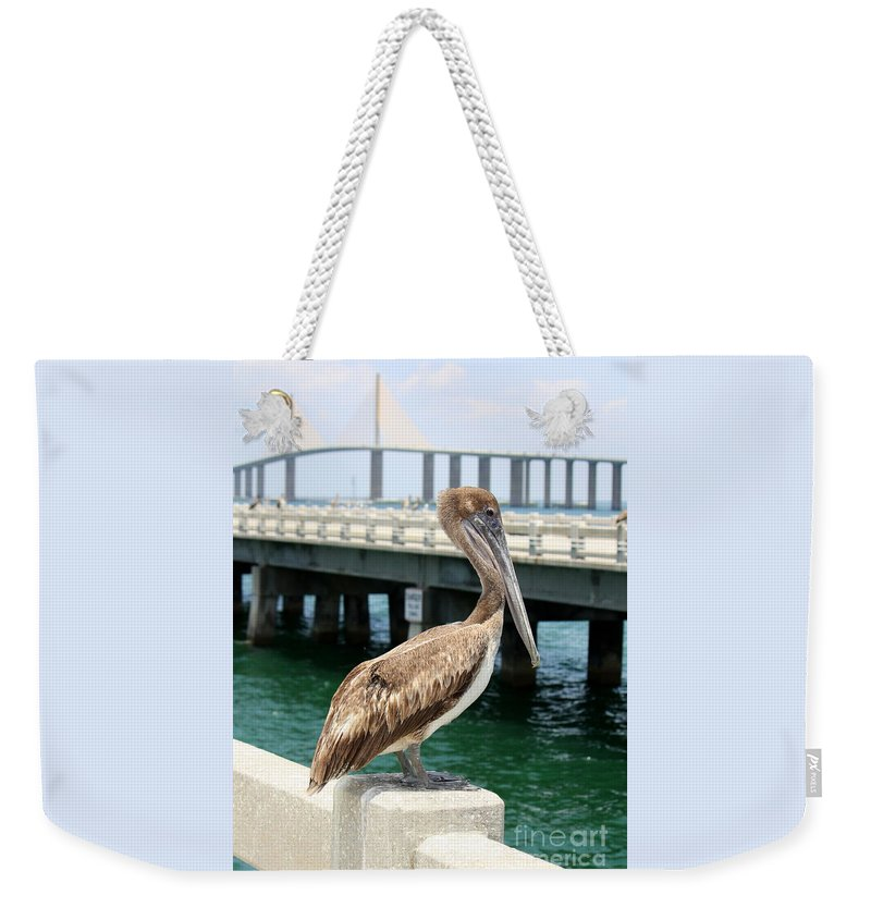 Sunshine Skyway Bridge Weekender Tote Bag featuring the photograph Sunshine Skyway And Pelican by Carol Groenen
