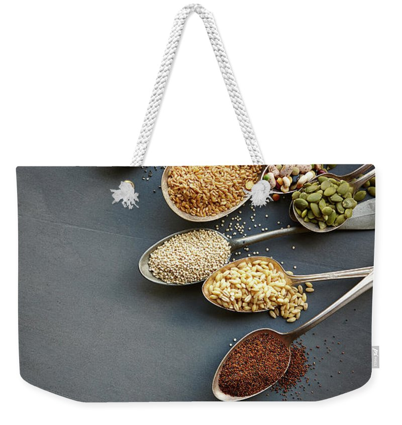 In A Row Weekender Tote Bag featuring the photograph Super Food Grains On Spoons by Lew Robertson