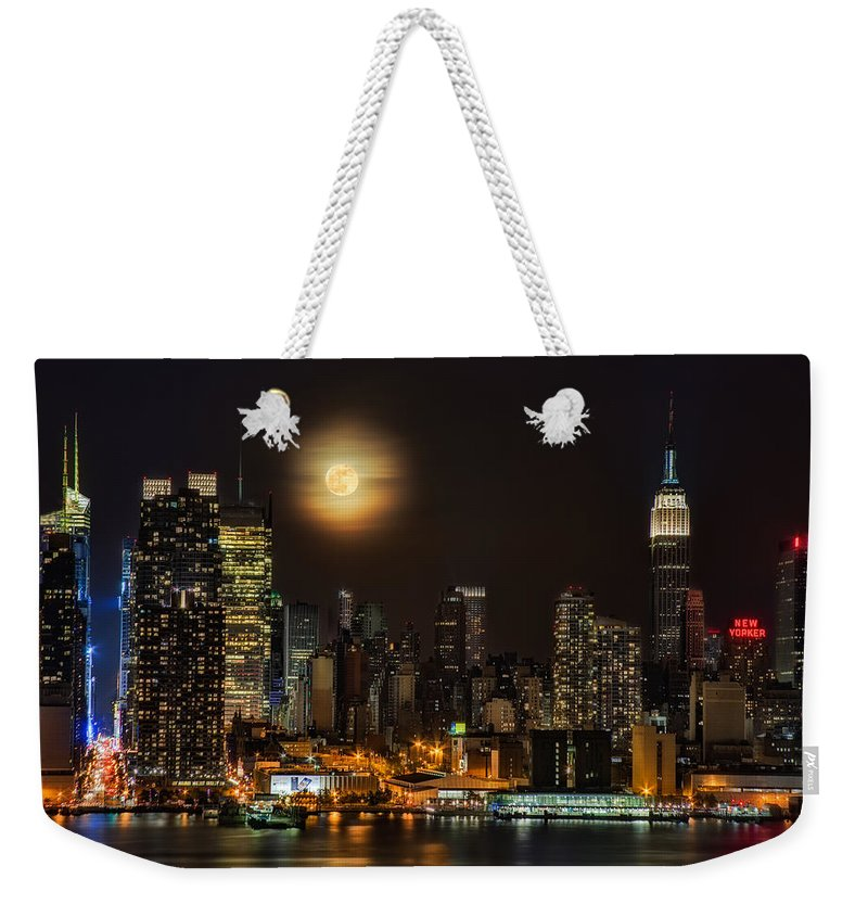Empire State Building Weekender Tote Bag featuring the photograph Super Moon Over Nyc by Susan Candelario