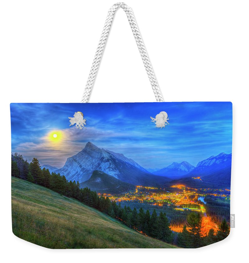 Alan Dyer Weekender Tote Bag featuring the photograph Super Moonrise Over Banff by Alan Dyer