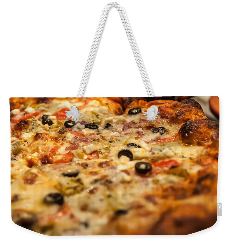 American Weekender Tote Bag featuring the photograph Supreme Meat Works Pizza Sliced And Ready To Eat by Alex Grichenko