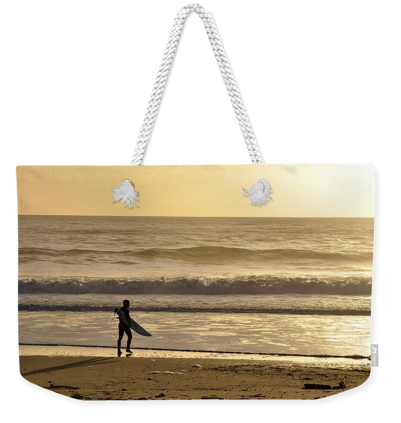 Scenic Weekender Tote Bag featuring the photograph Surfer At Sunset by AJ Schibig