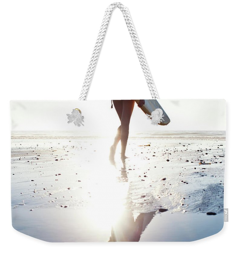 Youth Culture Weekender Tote Bag featuring the photograph Surfer Girl by Ianmcdonnell