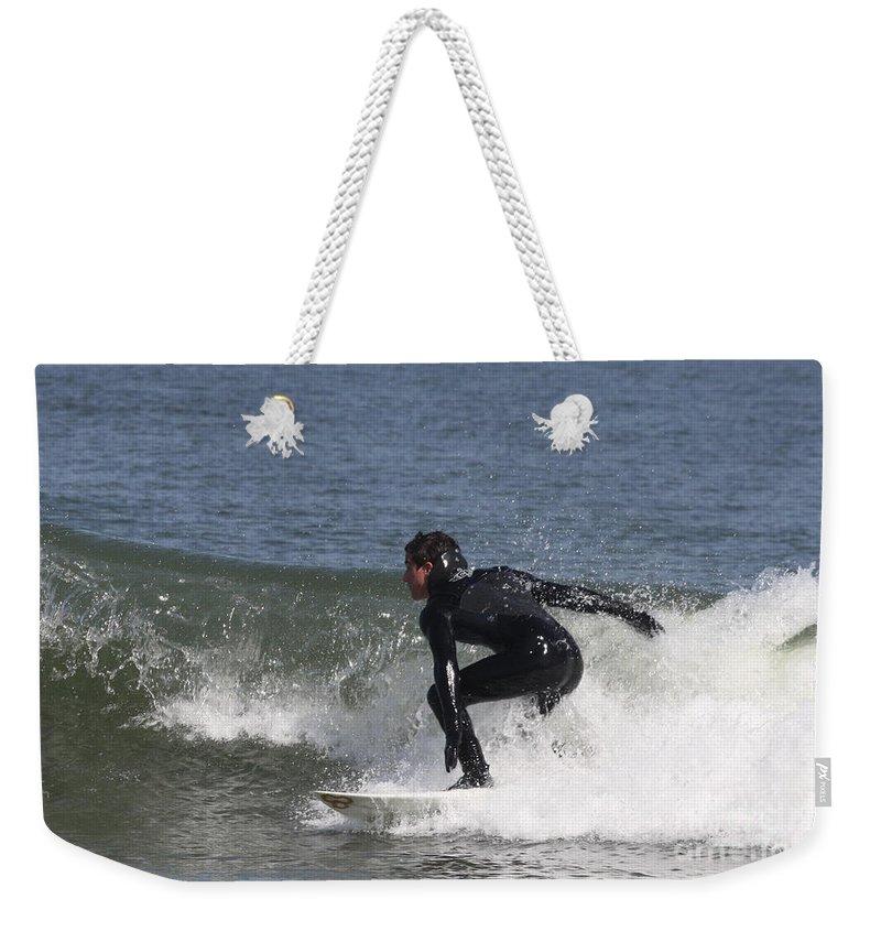 Surfer Hitting The Curl Weekender Tote Bag featuring the photograph Surfer Hitting The Curl by John Telfer