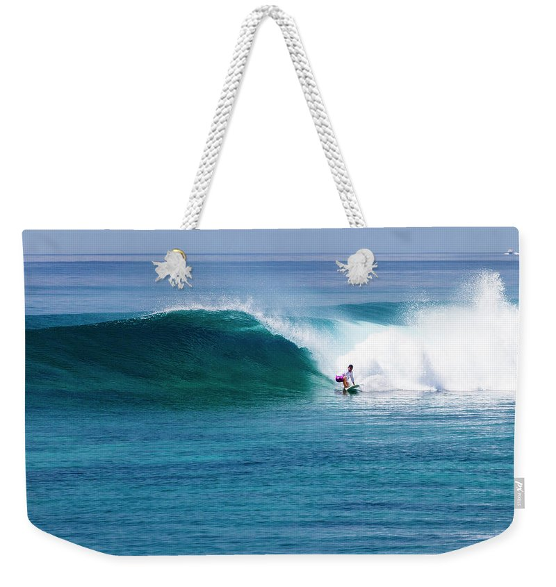Recreational Pursuit Weekender Tote Bag featuring the photograph Surfer Surfing A Wave by Subman