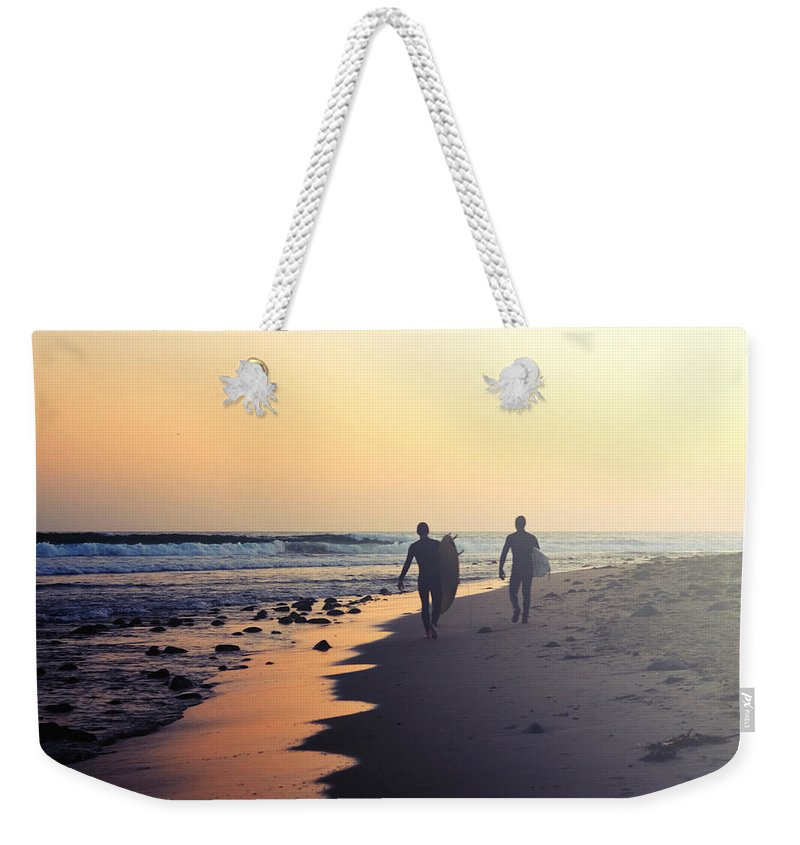 Water's Edge Weekender Tote Bag featuring the photograph Surfing Rincon Point Surfers Beach by Amparo E. Rios