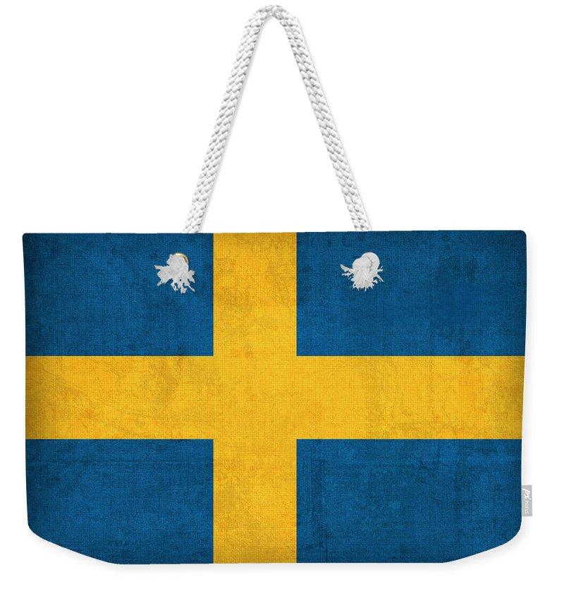 Sweden Flag Vintage Distressed Finish Weekender Tote Bag featuring the mixed media Sweden Flag Vintage Distressed Finish by Design Turnpike