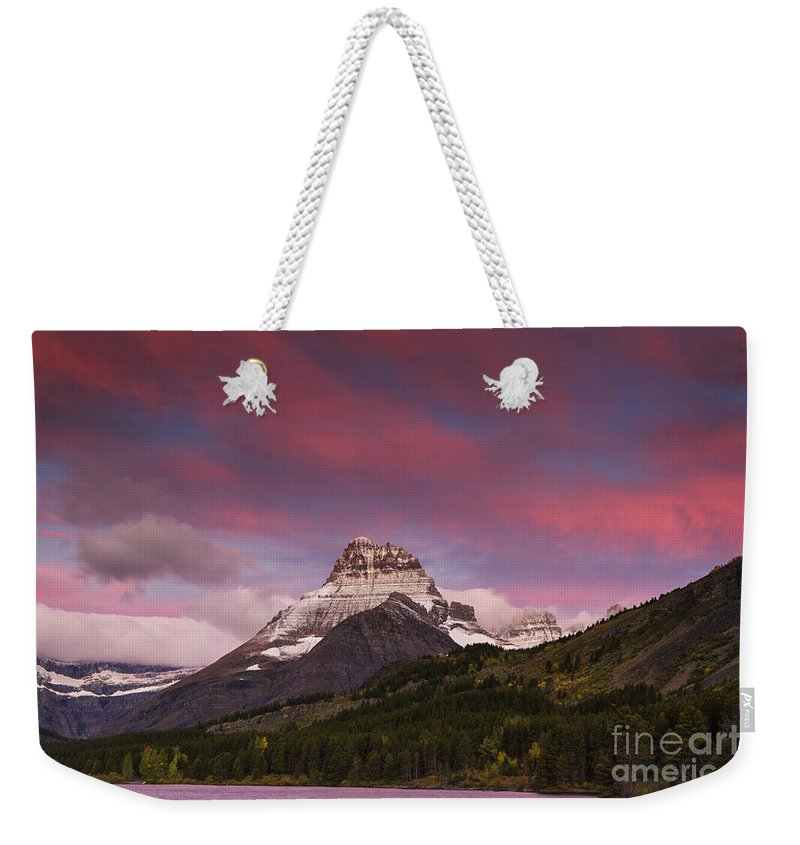 Calm Weekender Tote Bag featuring the photograph Swiftcurrent Sunrise by Mark Kiver