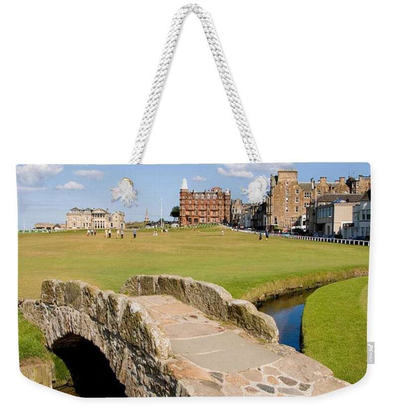 Golf Weekender Tote Bag featuring the photograph Swilcan Bridge On The 18th Hole At St Andrews Old Golf Course Scotland by Unknown