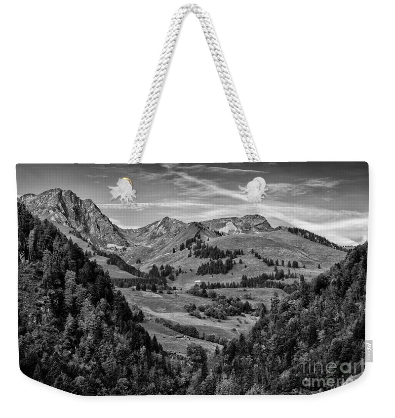 Leysin Weekender Tote Bag featuring the photograph Swiss Valley Bw by Timothy Hacker