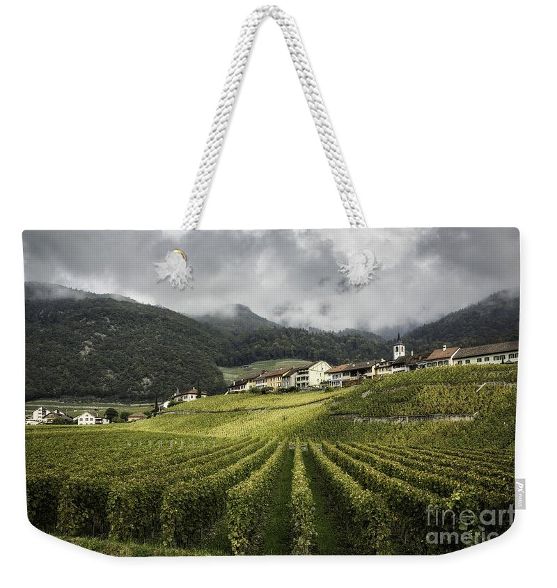 Lake Geneva Weekender Tote Bag featuring the photograph Swiss Vineyard by Timothy Hacker