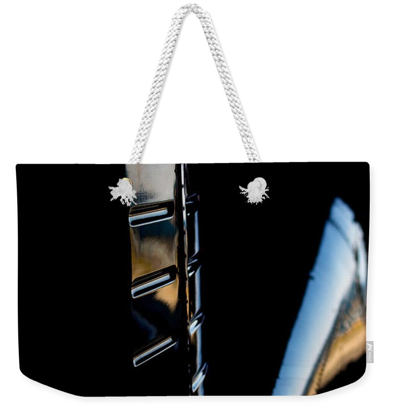 Cirrus Sr22 Weekender Tote Bag featuring the photograph Tail Reflection by Paul Job