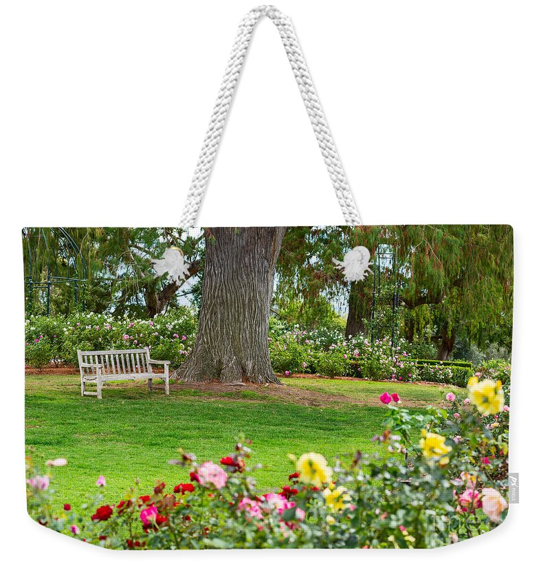 Rose Garden Weekender Tote Bag featuring the photograph Take A Seat - Beautiful Rose Garden Of The Huntington Library. by Jamie Pham