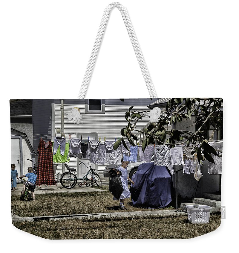 Amish Weekender Tote Bag featuring the photograph Taking Out The Garbage - Sarasota - Florida by Madeline Ellis