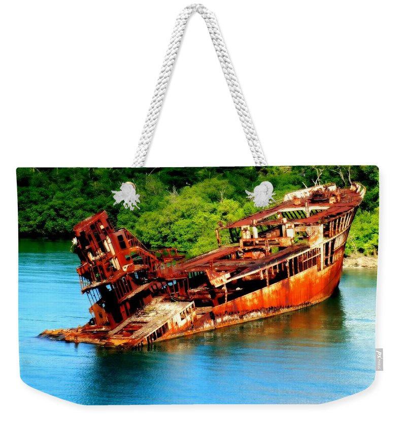 Shipwrecks Weekender Tote Bag featuring the photograph Tales Of Rust by Karen Wiles