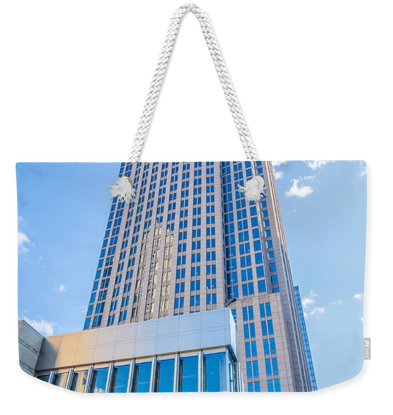 America Weekender Tote Bag featuring the photograph Tall Highrise Buildings In Uptown Charlotte Near Blumental Perfo by Alex Grichenko