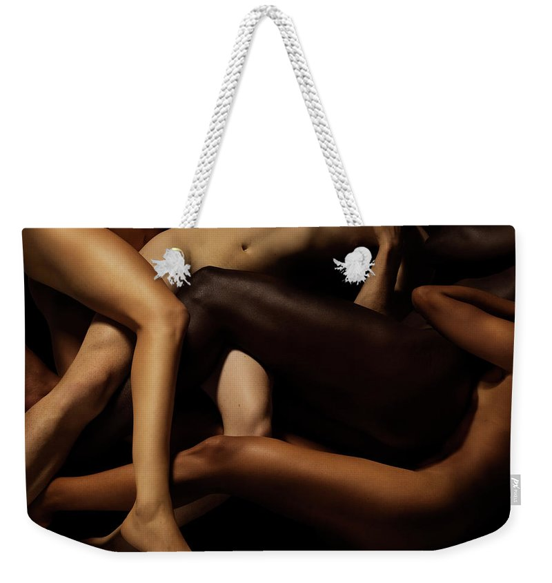 Young Men Weekender Tote Bag featuring the photograph Tangled Human Bodies Of Different Skin by Jonathan Knowles