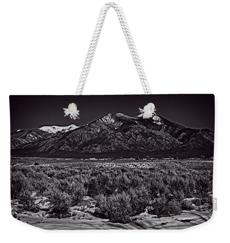 Santa Weekender Tote Bag featuring the photograph Taos Mountain In Black And White by Charles Muhle