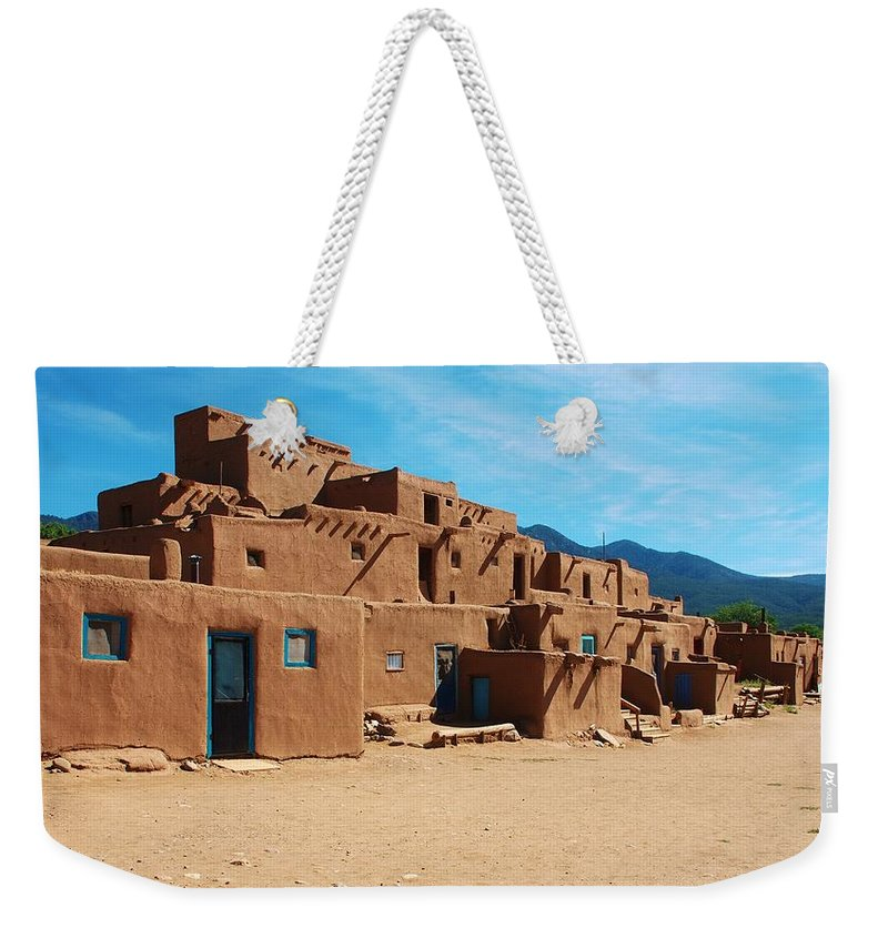 Adobe Weekender Tote Bag featuring the photograph Taos Pueblo 4 by Dany Lison