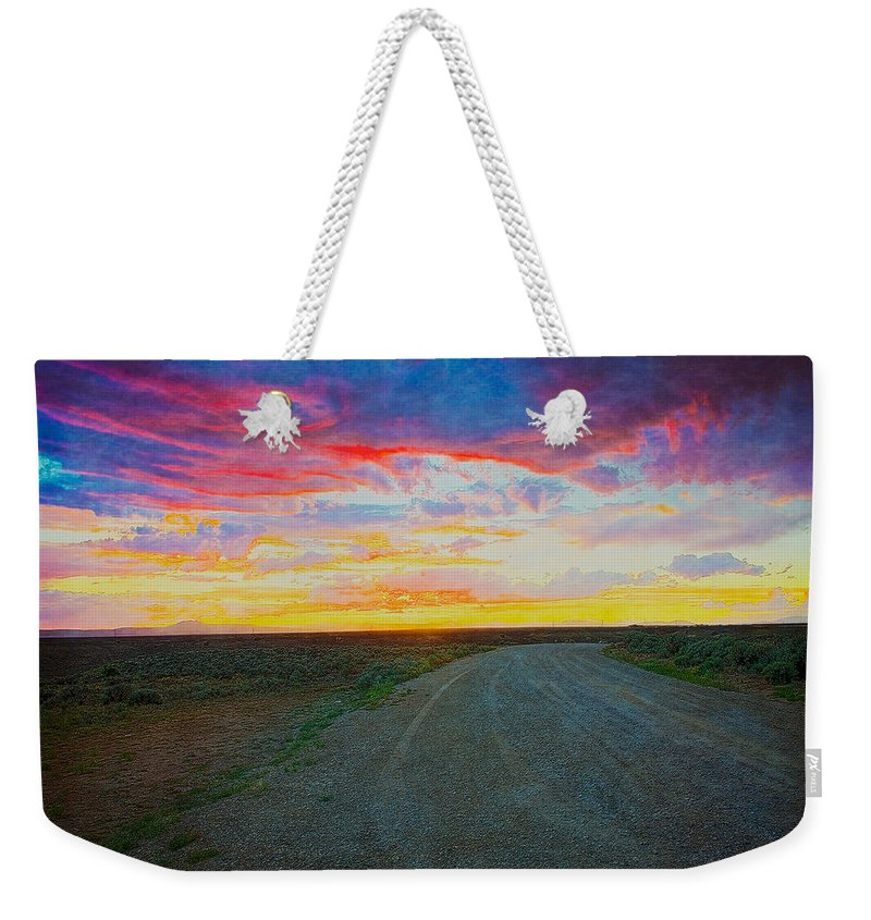 Taos Weekender Tote Bag featuring the photograph Taos Sunset On Rice Paper by Charles Muhle