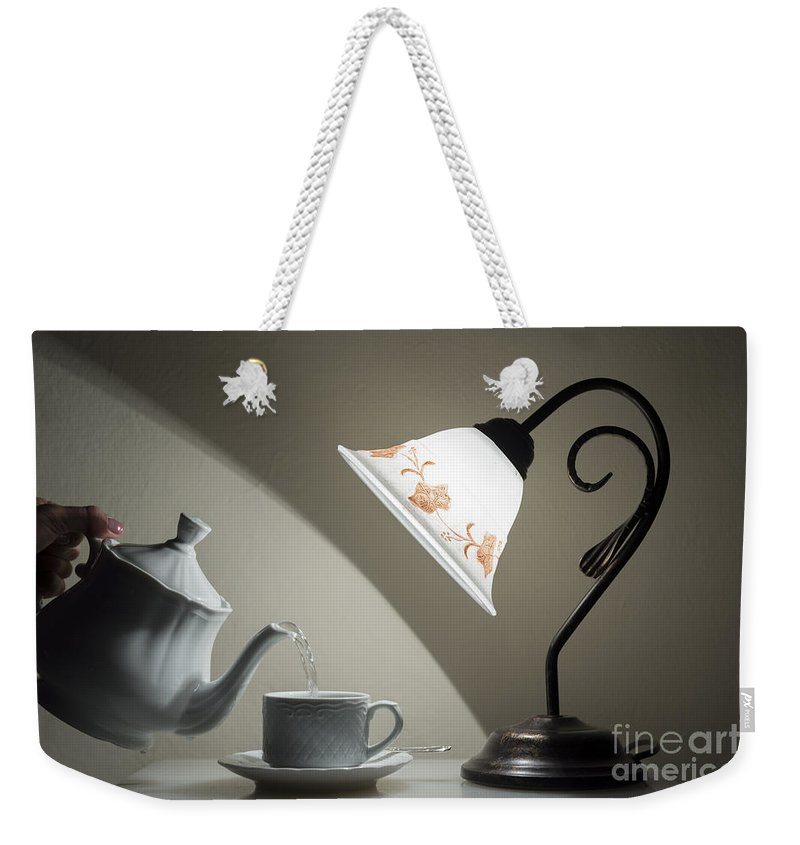 Tea Time Weekender Tote Bag featuring the photograph Tea Time by Mats Silvan
