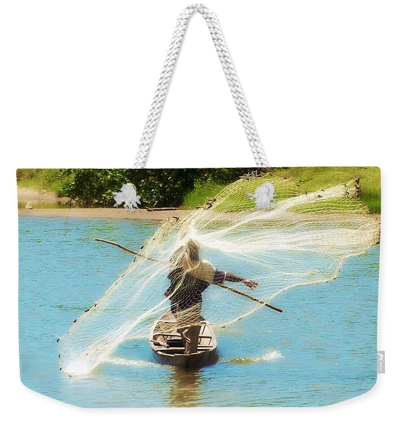Fish Weekender Tote Bag featuring the photograph Teach A Man To Fish by Jamie Johnson
