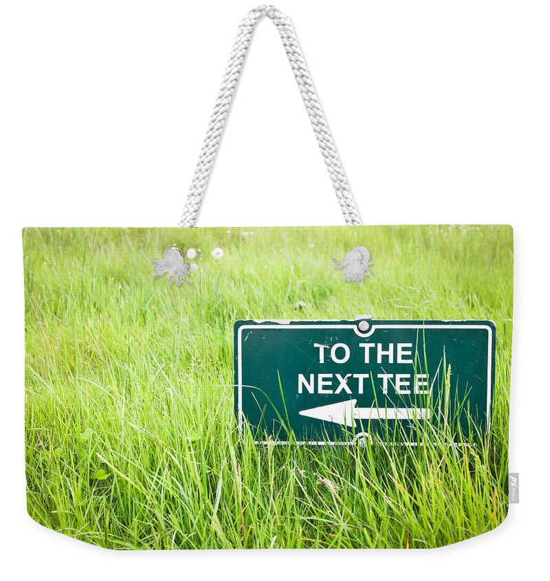 Arrow Weekender Tote Bag featuring the photograph Tee Sign by Tom Gowanlock