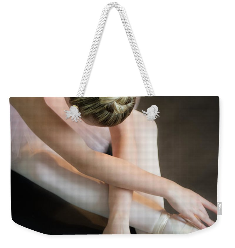 Ballet Dancer Weekender Tote Bag featuring the photograph Teenage 16-17 Ballerina Bending Over by Jamie Grill