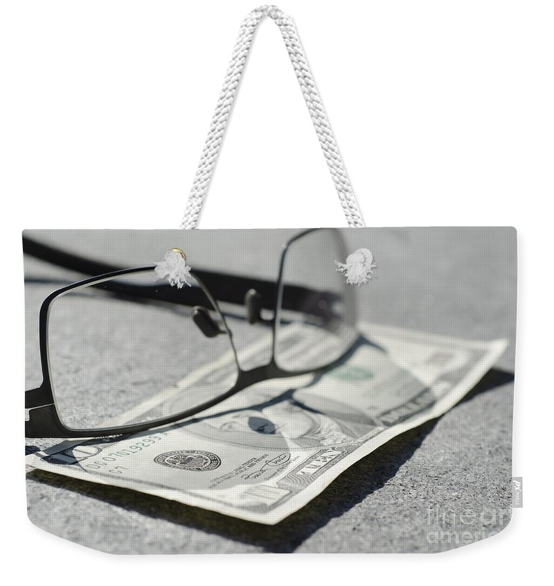 Money Weekender Tote Bag featuring the photograph Ten Dollar And Eyeglasses by Mats Silvan