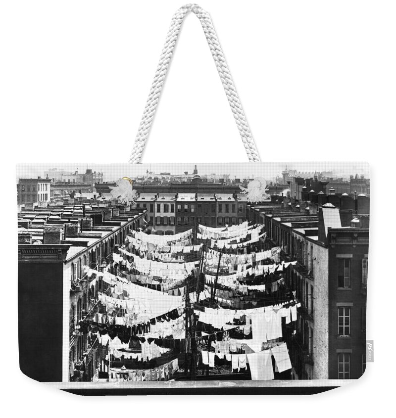 1900 Weekender Tote Bag featuring the photograph Tenement Housing Laundry by Underwood Archives