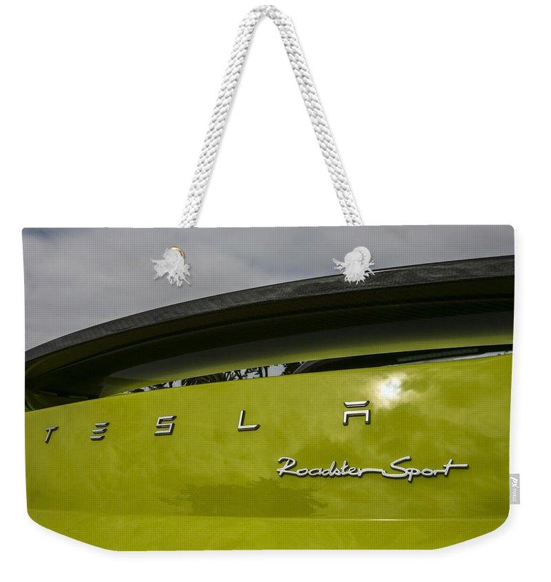 Tesla Weekender Tote Bag featuring the photograph Tesla Roadster by Jose Bispo