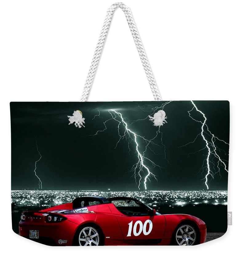 Tesla Weekender Tote Bag featuring the photograph Tesla by Sylvia Thornton
