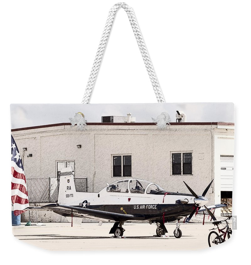 Transportation Weekender Tote Bag featuring the photograph Texan Trainer by Melinda Ledsome