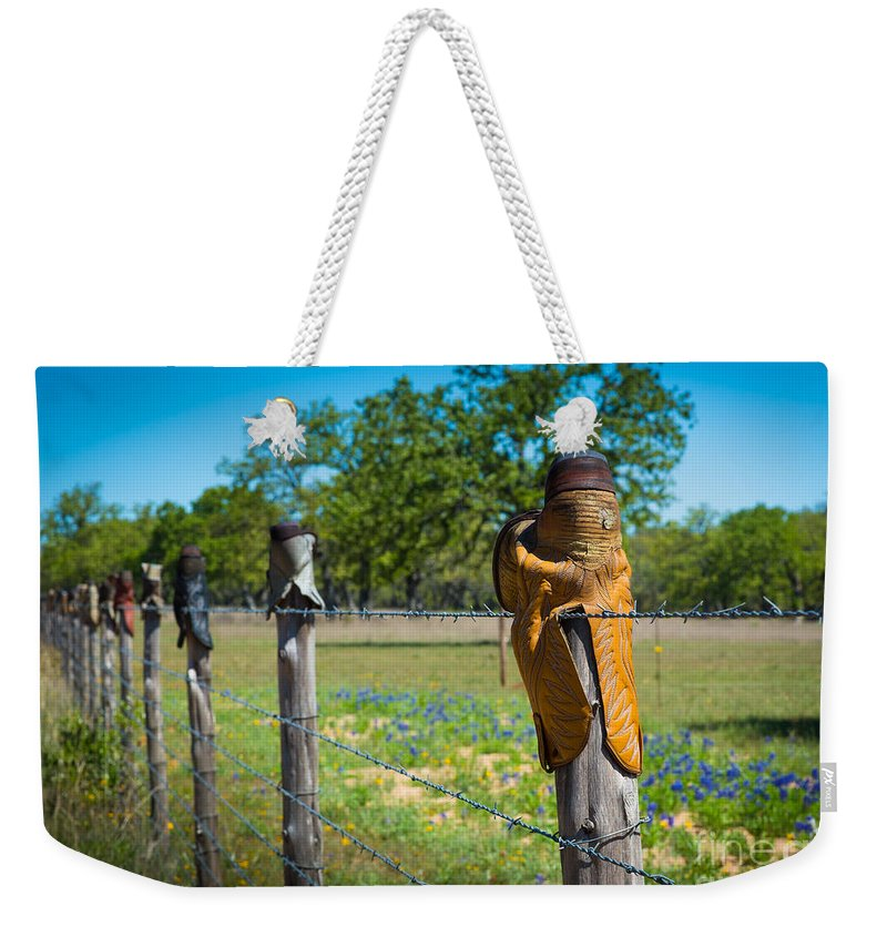 America Weekender Tote Bag featuring the photograph Texas Boot Fence by Inge Johnsson