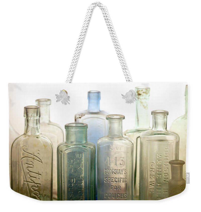 Bottle Weekender Tote Bag featuring the photograph The Ages Reflected in Glass by Holly Kempe