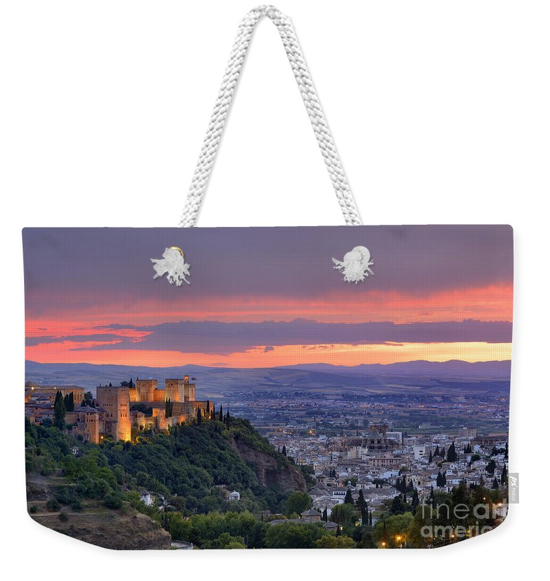 The Alhambra Weekender Tote Bag featuring the photograph The Alhambra And Granada City At Sunset by Guido Montanes Castillo