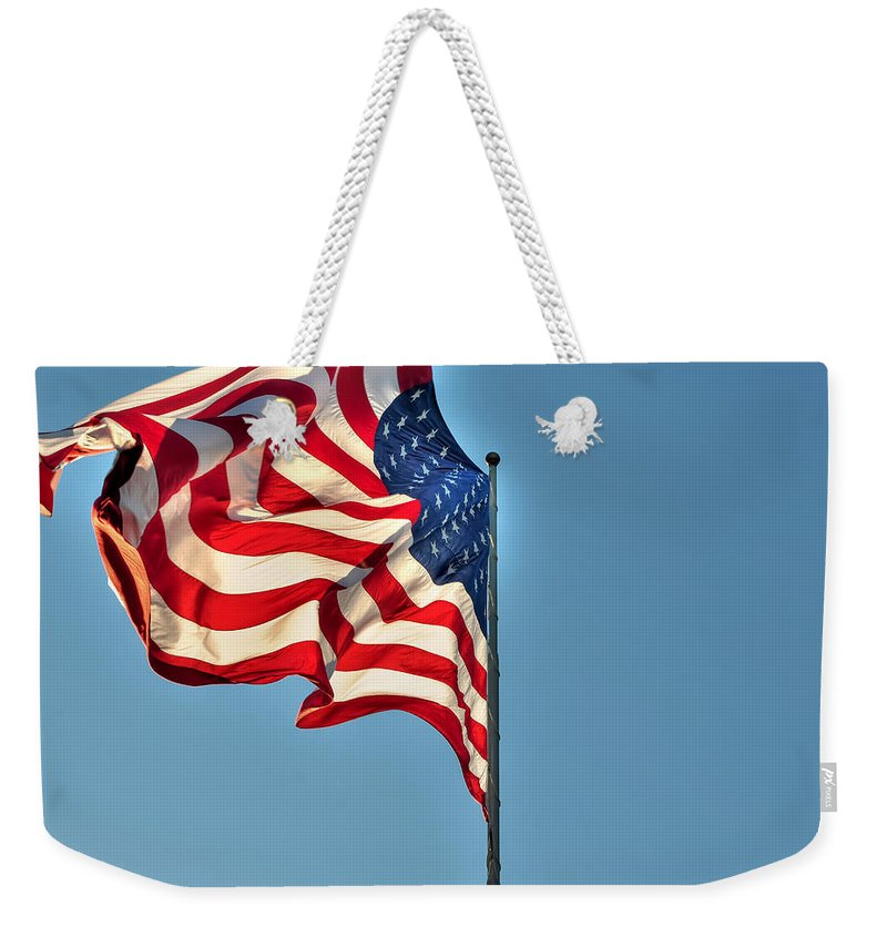 American Flag Weekender Tote Bag featuring the photograph The American Flag No Retreat No Surrender by Michael Frank Jr