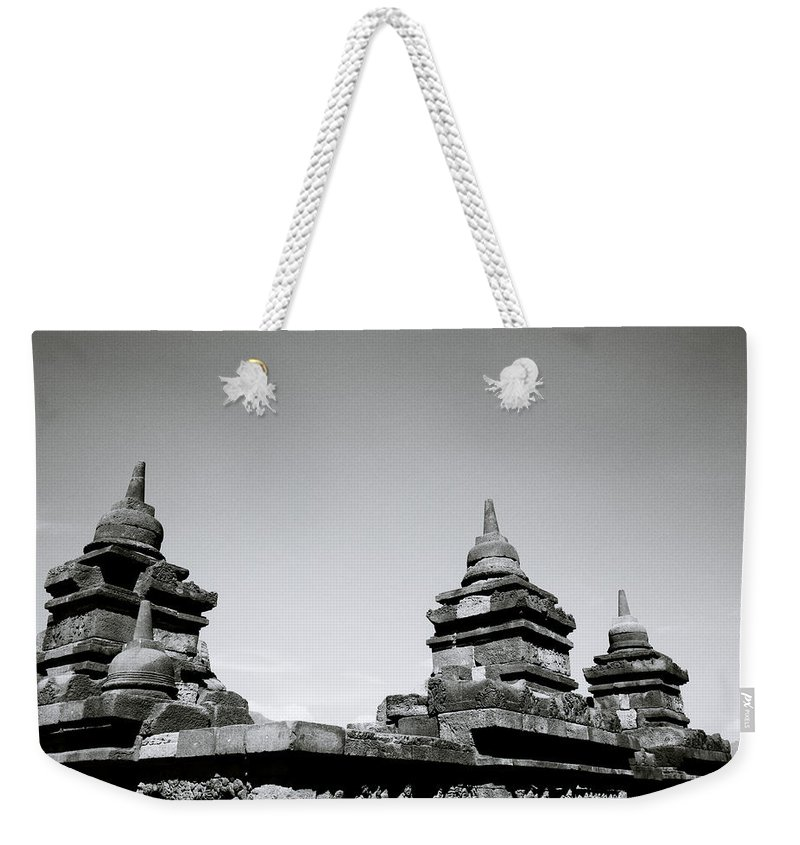 Borobudur Weekender Tote Bag featuring the photograph The Ancient Stupas Of Borobudur by Shaun Higson