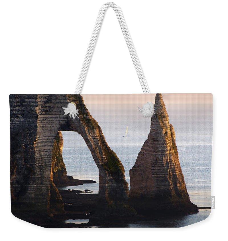 Sea Weekender Tote Bag featuring the photograph The Aval Door In Etretat France by Jaroslaw Blaminsky