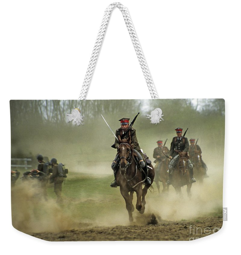 Cavalry Weekender Tote Bag featuring the photograph The Battle by Angel Ciesniarska